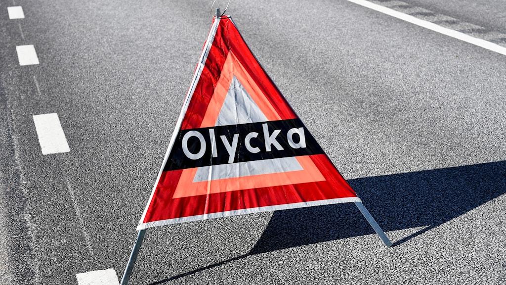 """Varningstriangel med texten """"Olycka"""". Foto: Johan Nilsson/TT"""