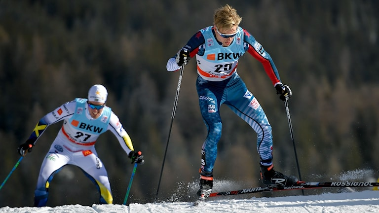 Erik Bjornsen of the US (R) and Sweden's Calle Halfvarsson compete the Men's 15 km pursuit free during the cross country FIS World cup Tour de Ski event on January 1, 2018.