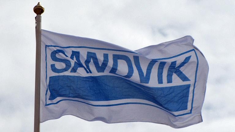 Flagga med texten Sandvik.