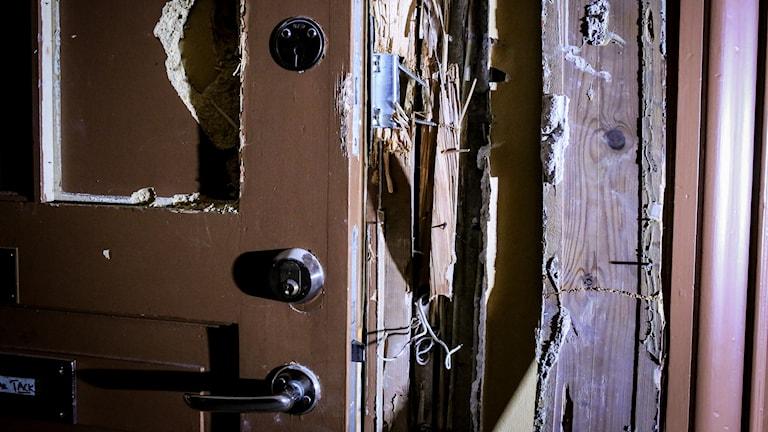 uppbruten dörr