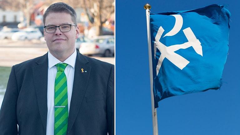 Anders Wigelsbo vid sidan av flagga med Sala kommuns logga.