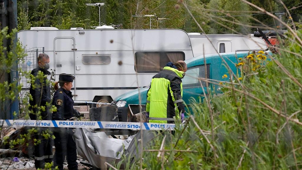 Polis vid migranters husvagnar. Arkivfoto: Christine Olsson/TT