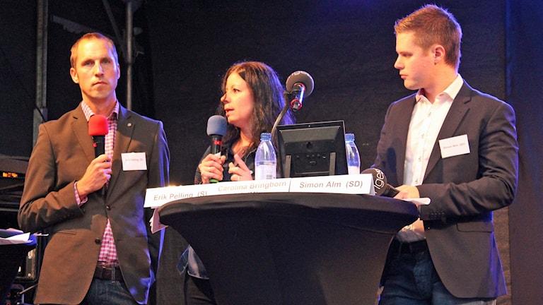 Erik Pelling (S), Carolina Bringborn Anadol (M) och Simon Alm (SD). Foto: Sveriges Radio