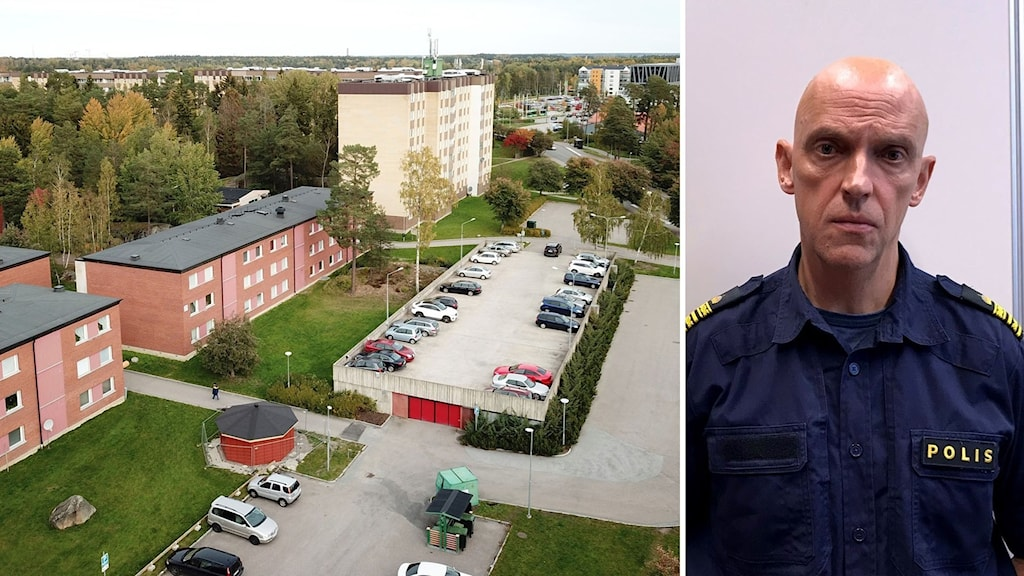 Höghus, parkering och en man i polisuniform
