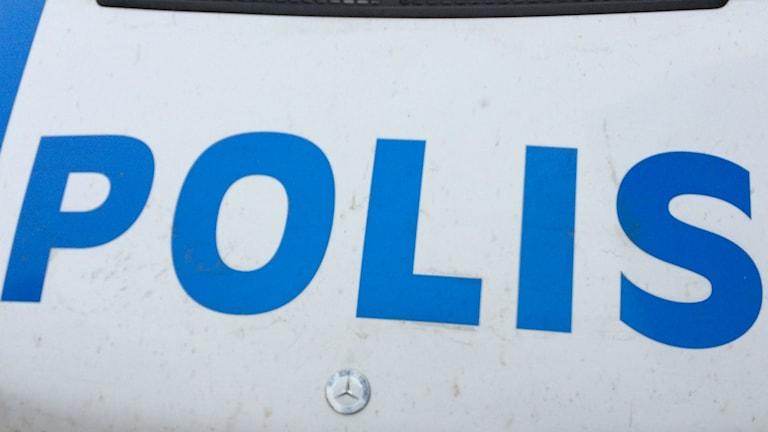 "Bild på texten ""polis"""