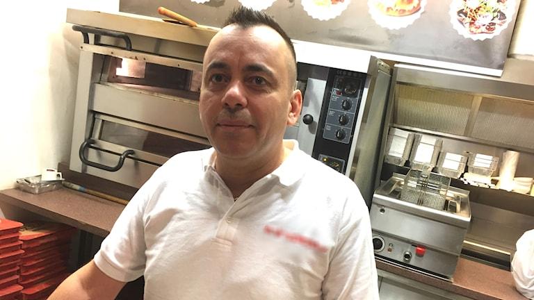 Porträtt av pizzabagaren Alan Ibrahim