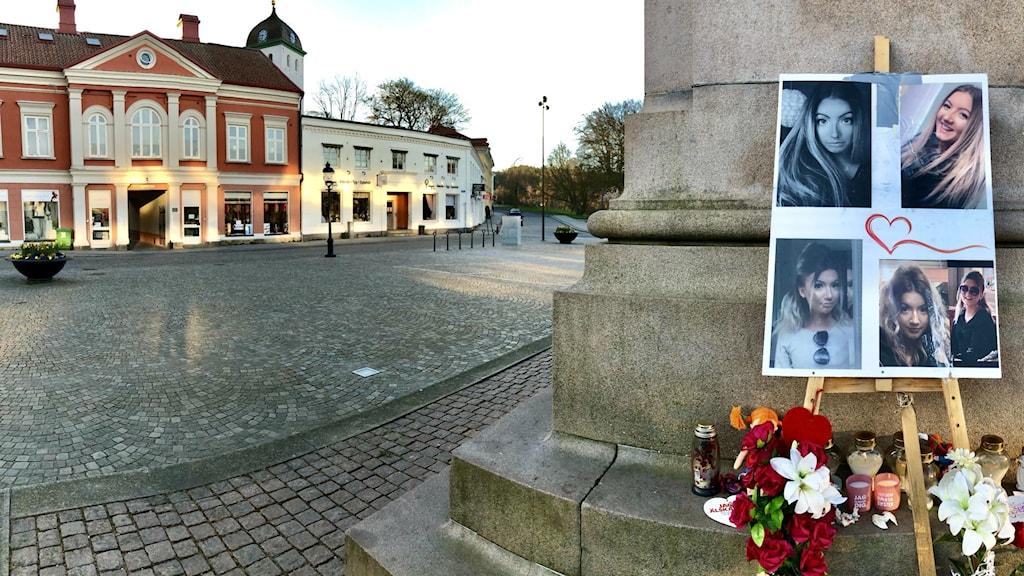 Wilmas minnesplats på torget, en tidig, halvmulen morgon. Klocktornet tecknar sig i bakgrunden.