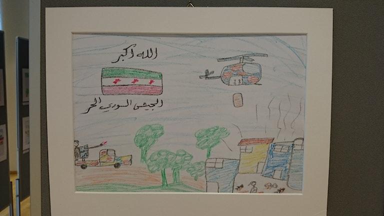 Barnmålningar från ett sargat Syrien. Foto: Sveriges Radio