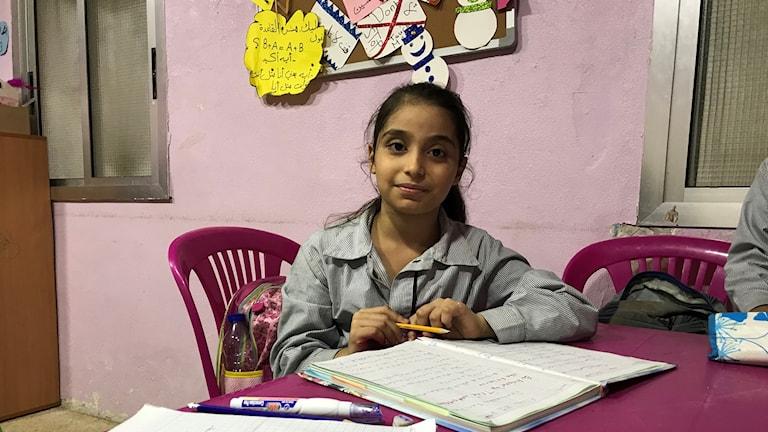 Amina bor i flyktinglägret.