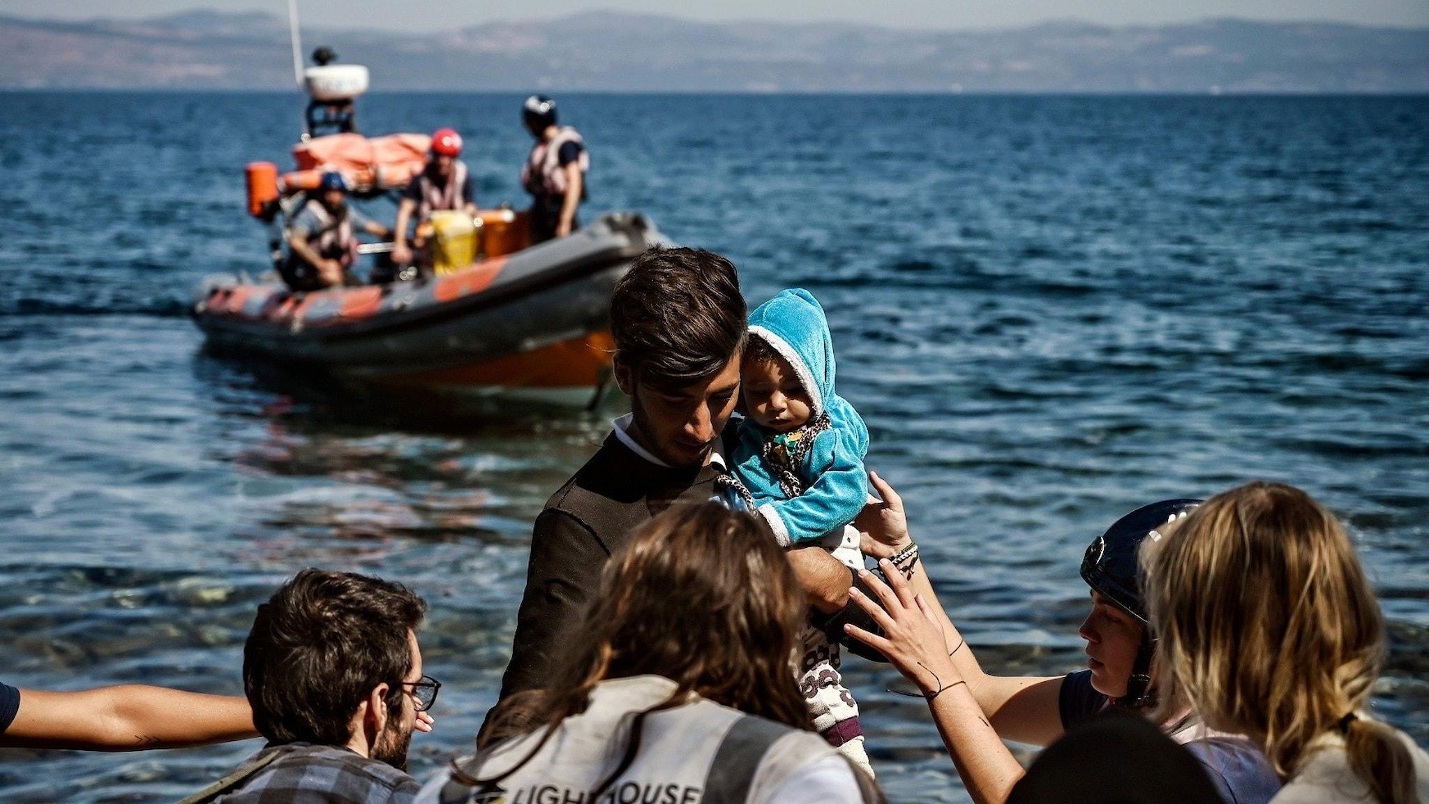 Flyktingar anländer till Lesbos