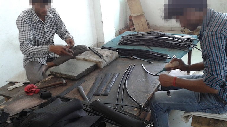 Arbetare i fabrik i Kanpur, Indien
