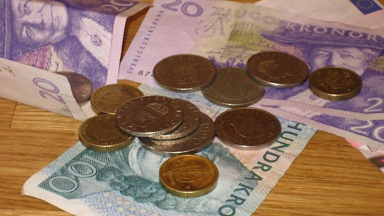 Sedlar och mynt. Foto: Linnéa Pettersson/Sveriges