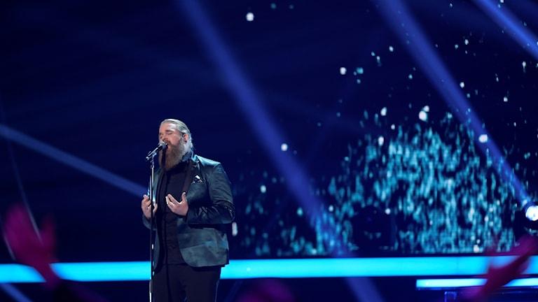 På bilden syns Chris Kläfford under Idol-finalen i Globen.