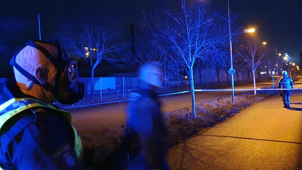 Polis i Gasmask