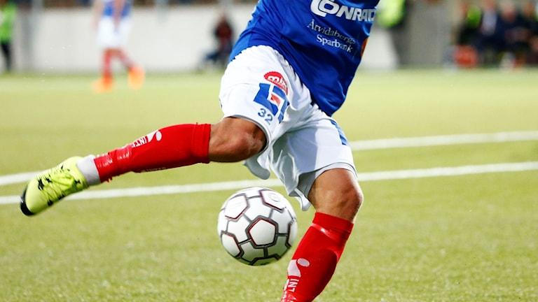 Benen på en fotbollsspelare