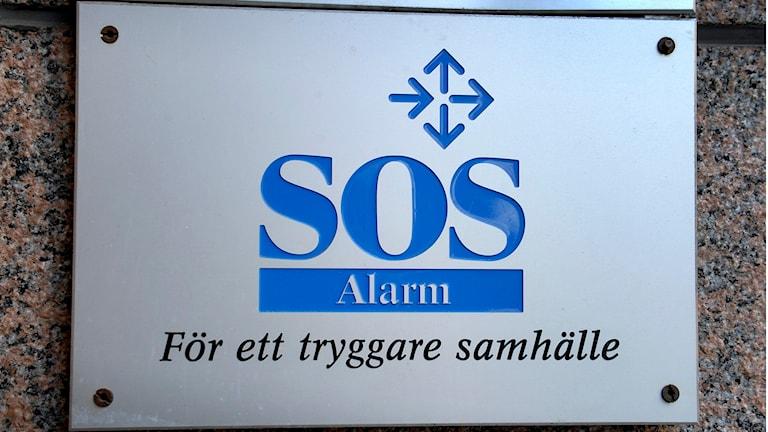 Skylten utanför SOS Alarms huvudkontor i Stockholm. Foto: Janerik Henriksson/TT