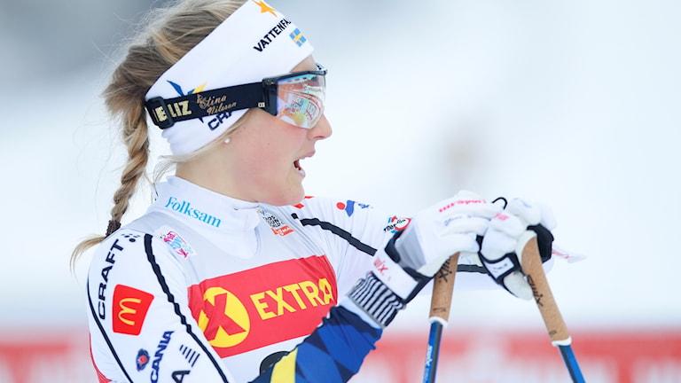 Stina Nilsson i skiddräkt.