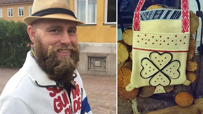 Leende man med skägg och hatt och bild på en dekorerad skinnväska