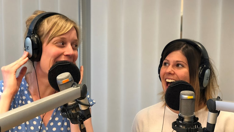 Two women singing into a microphone.