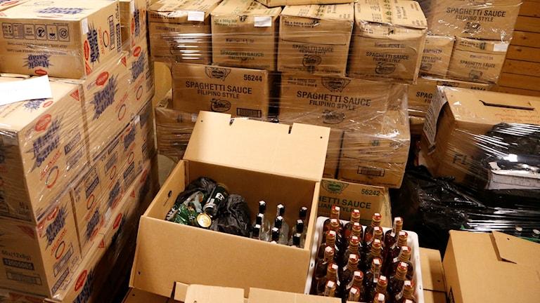 Beslagtagna alkoholflaskor hos Tullverket