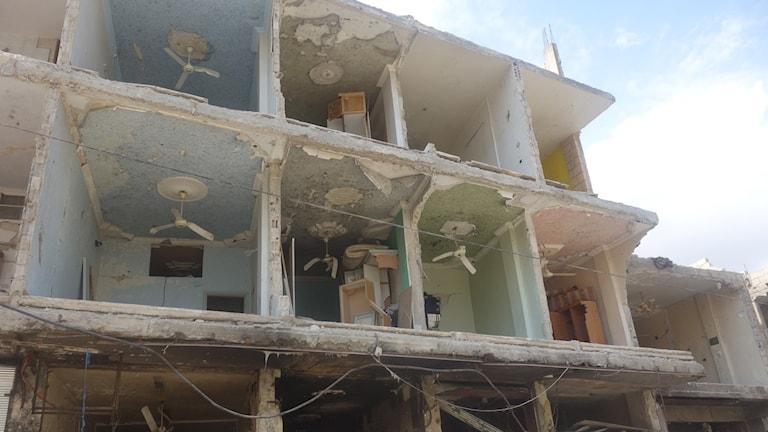 Bortslitna fasader efter bombdåd i Sayyidah Zaynab
