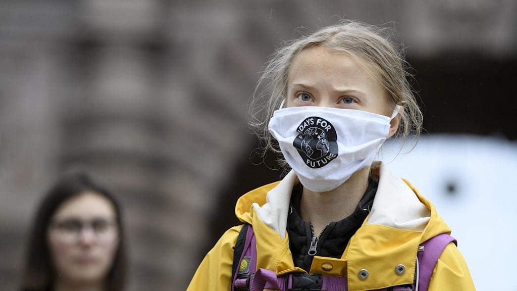 Bild på Greta Thunberg med munskydd