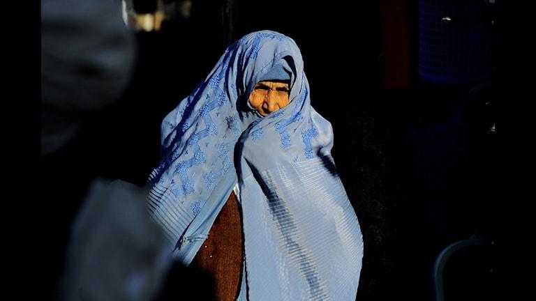 Kvinna, burka Foto: Aref Karimi/AFP