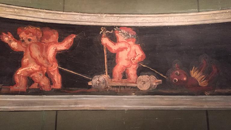 Målning där Julius Ceasar drar en svart person bakom en kärra på hjul.