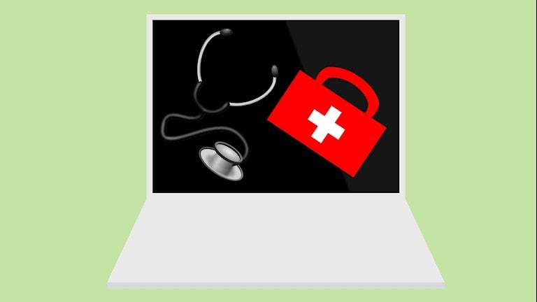 Bild på dator med medicinväska på