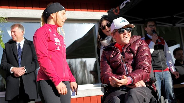 Holmlund tillsammans med Charlotte Kalla.