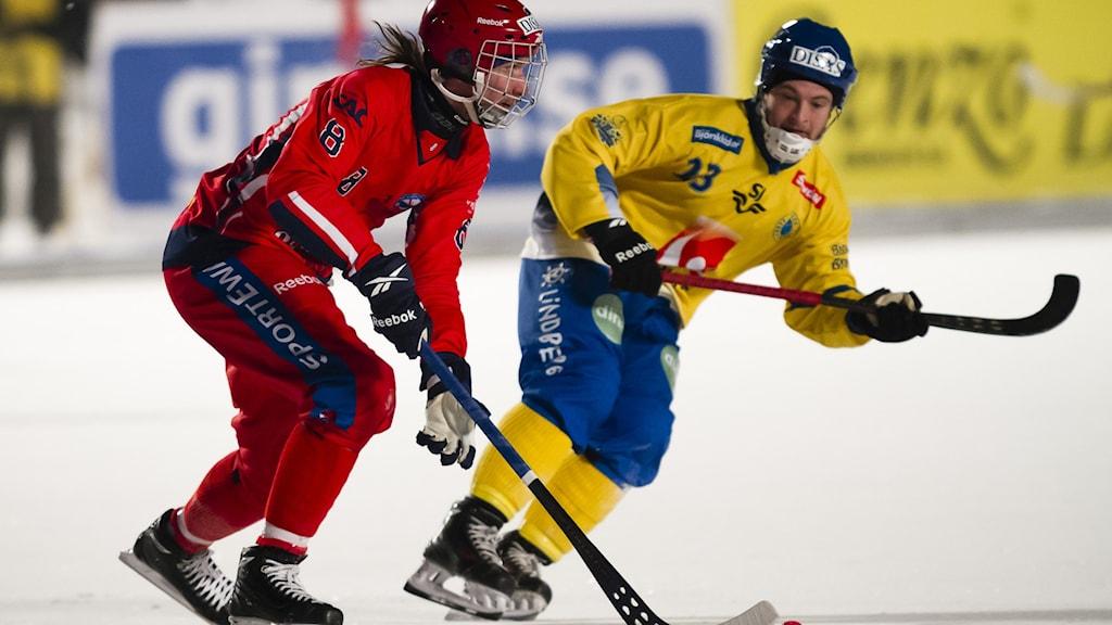 Rysslands Maxim Ishkeldin och Sveriges Christoffer Edlund i VM 2014.