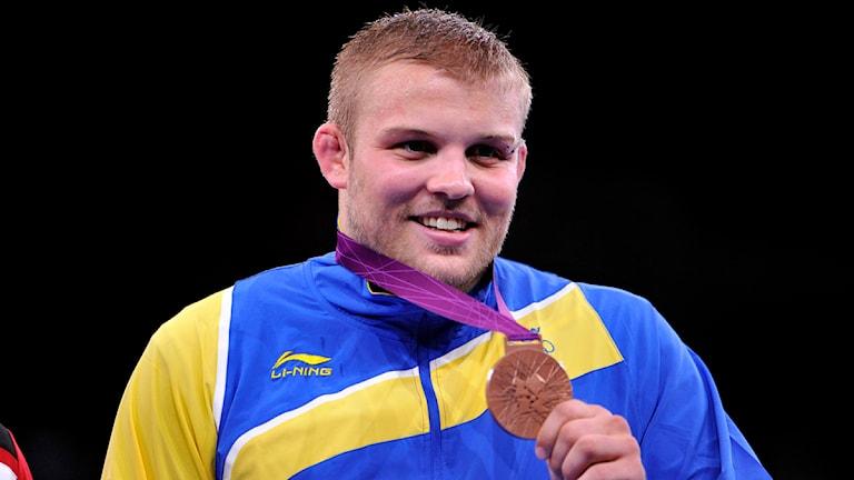 Johan Eurén med bronsmedaljen. Foto: Tobias Röstlund/Scanpix