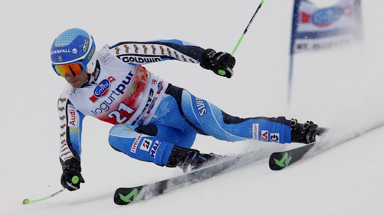 Matts Olsson of Sweden speeds down the course during the first run of an alpine ski men's World Cup giant slalom in St. Moritz, , Switzerland, Sunday, Feb. 2, 2014. AP Photo/Marco Trovati