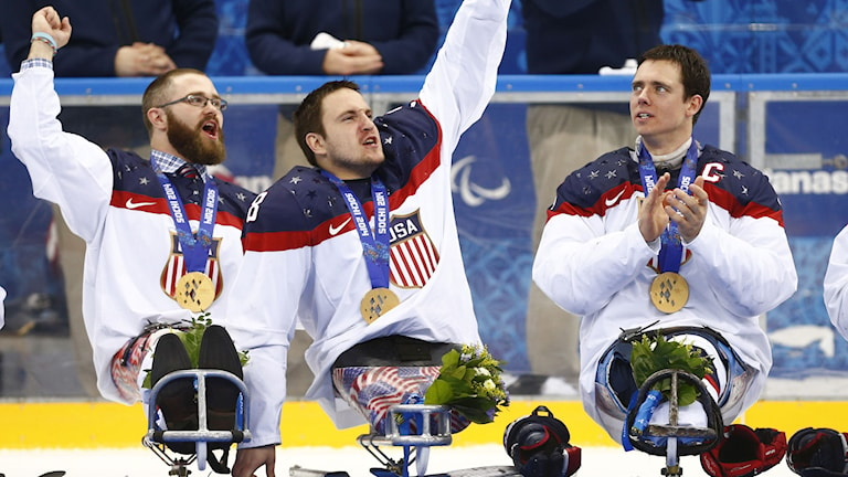 United States players Taylor Lipsett, left, Greg Shaw, center, and Andy Yohe celebrate after winning the gold medal ice sledge hockey match against Russia at the 2014 Winter Paralympics in Sochi, Russia, Saturday, March 15, 2014. United States won 1-0. AP Photo/Pavel Golovkin