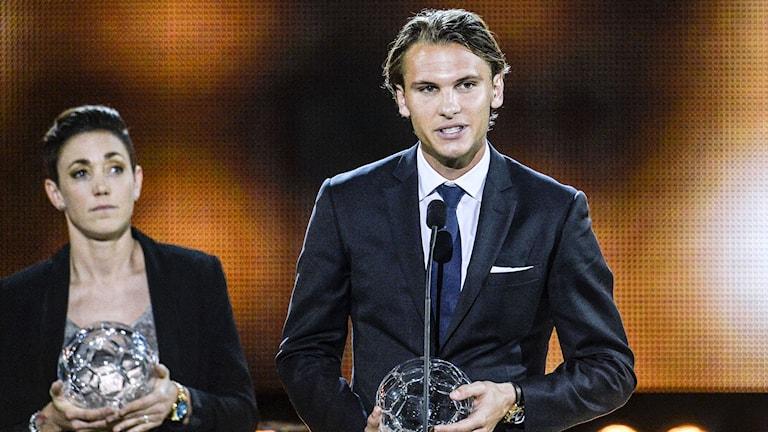 Therese Sjögran och Albin Ekdal under Fotbollsgalan 2014. Foto: Anders Wiklund / TT