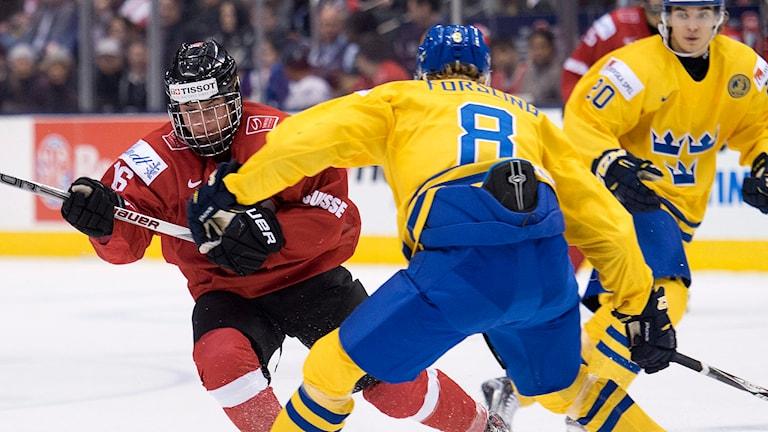 Sverige stoppade Schweiz i JVM i Toronto. Foto: TT