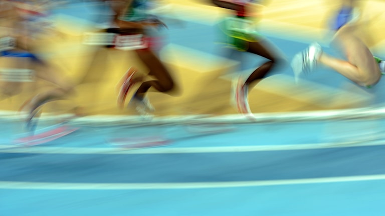 Athletes compete during the women's 3000m qualifications at the 2012 IAAF World Indoor Athletics Championships at the Atakoy Athletics Arena in Istanbul on March 9, 2012. AFP PHOTO / GABRIEL BOUYS