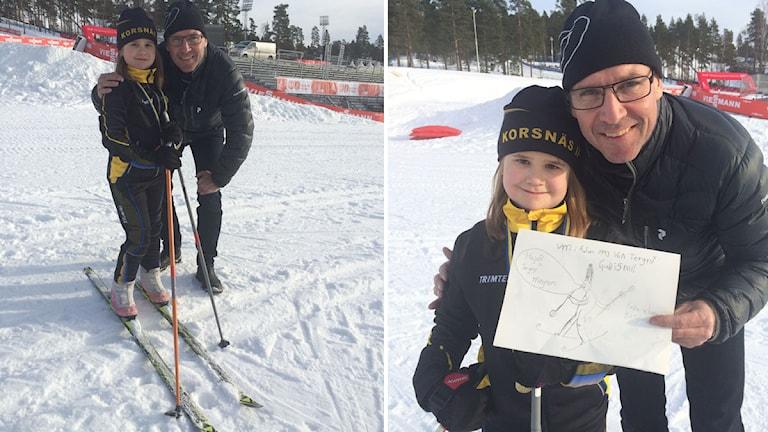 7-åriga Klara och Torgny Mogren vid VM-banorna i Falun. Foto: Linn Nenzén/Sveriges Radio