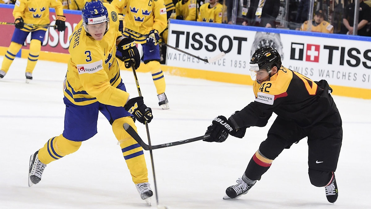 Forward Yasin Ehliz of Germany (R) tries to stop a shot from defender John Klingberg of Sweden during the group A preliminary round match Sweden vs Germany at the 2015 IIHF Ice Hockey World Championships on May 7, 2015 at the O2 Arena in Prague. AFP PHOTO/JONATHAN NACKSTRAND