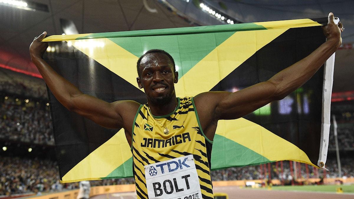 Usain Bolt efter VM-guldet på 100 meter. Foto: AFP/TT