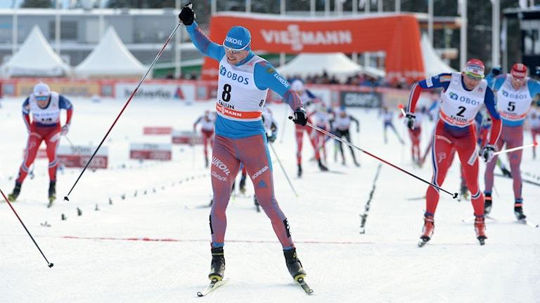 Sergej Ustiugov jublar efter segern i Falun