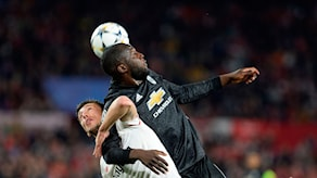 Manchester United's Belgian forward Romelu Lukaku (R) jumps for the ball with Sevilla's French defender Clement Lenglet (L) during the UEFA Champions League round of 16 first leg football match Sevilla FC against Manchester United at the Ramon Sanchez Pizjuan stadium in Sevilla on February 21, 2018. / AFP PHOTO / Cristina Quicler