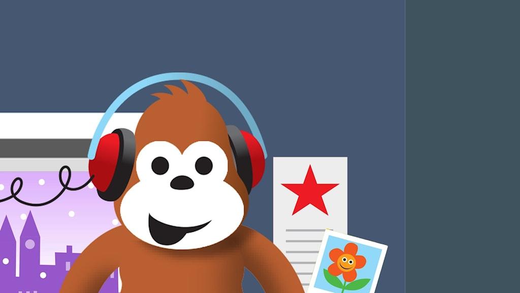 Gorilja kuuntelee musiikkia.