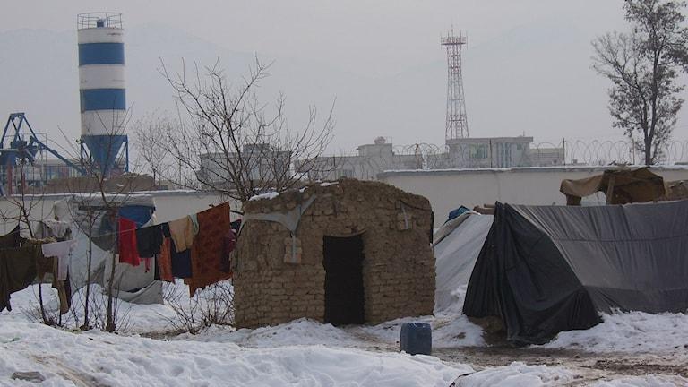 Pakolaisten asuntoja talvella