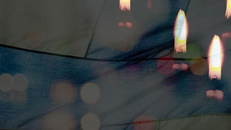 Suomen lippu ja kaksi kynttilää