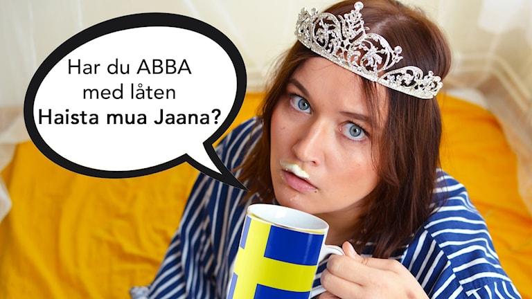 Anni muovikruunu päässään ja puhekupla: Har du ABBA med låten Haista mua Jaana?