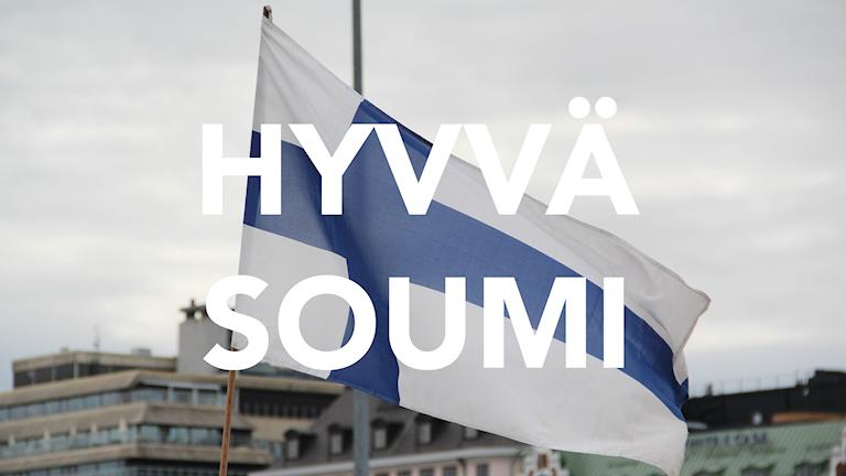 """Suomen lippu, jonka päällä teksti """"Hyvvä Soumi"""""""