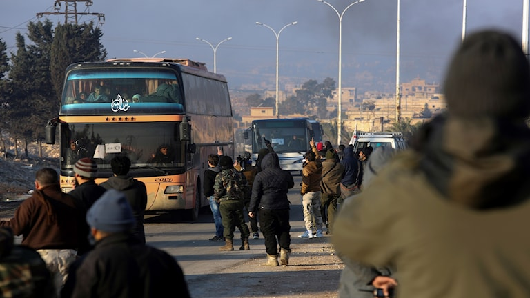 Syrians evacuated from the embattled Syrian city of Aleppo during the ceasefire on Monday.