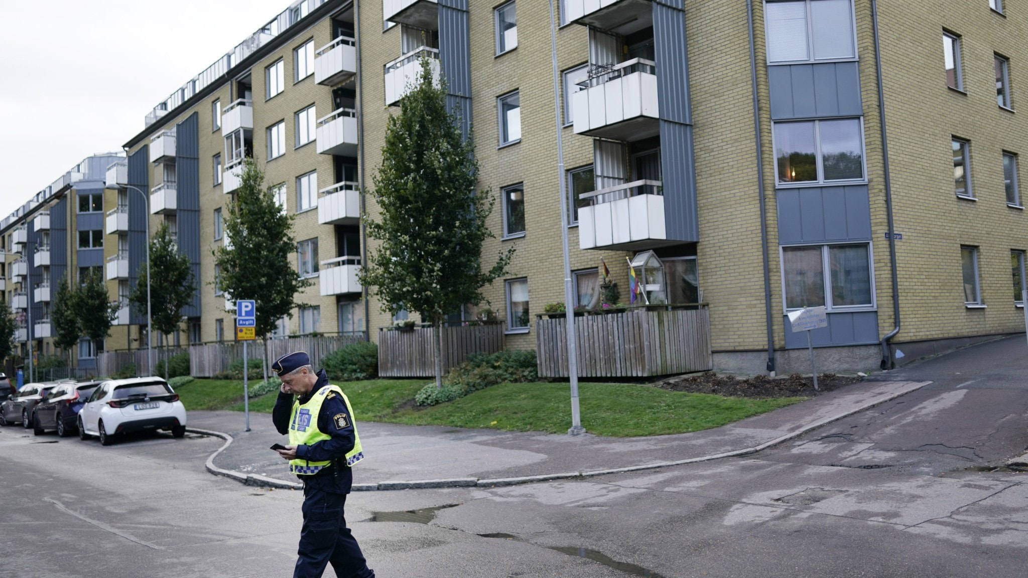 A policeman outside a block of flats in Annedal, Gothenburg.