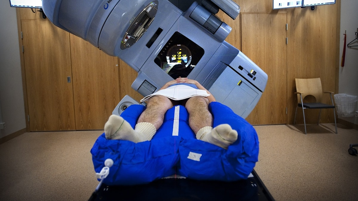 A patient going into a big medical machine.